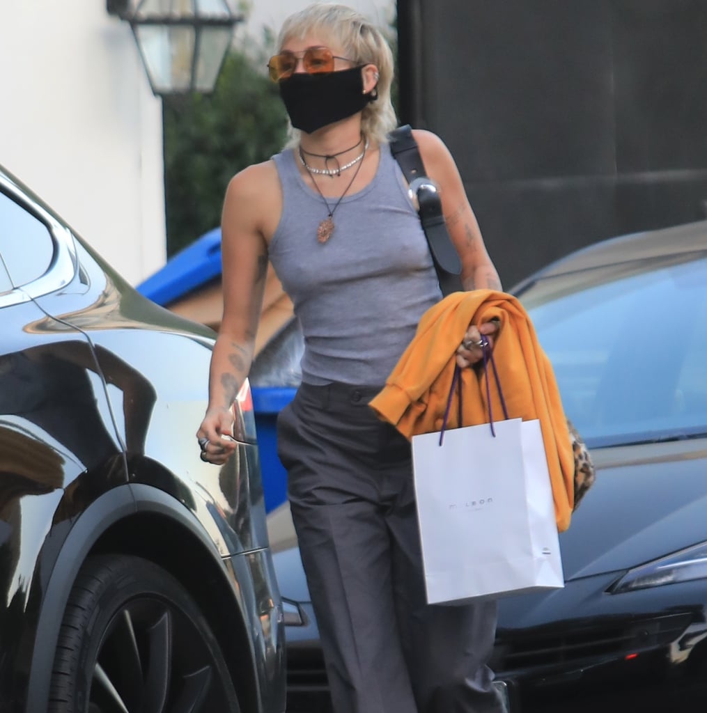 Miley Cyrus Wears a Gray Tank Top and Trousers