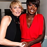 Robin Wright and Viola Davis hold hands.