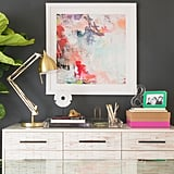 """I	especially	love	the	excitement	of	utilizing	a	black	accent	wall	as	well	as	the	mix	of	textures	and	finishes,"" explains designer Deanna, who strove for a ""clean-lined,	contemporary-glam	style."""