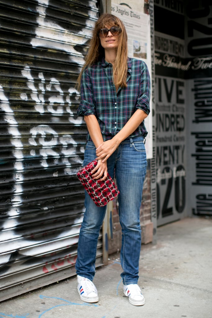 In plaid, sneakers, and denim, she gets our vote for one of the cutest casual looks at Fashion Week.
