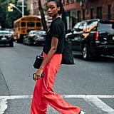 Go sporty-chic in a graphic t-shirt, track pants, and sneakers.