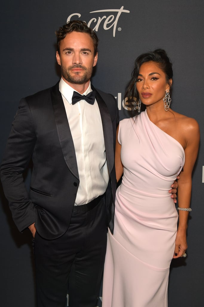 "It looks like there's a new celebrity couple in town! Nicole Scherzinger and Thom Evans appeared to make their relationship red carpet official at the 2020 Golden Globes on Sunday night as they walked the red carpet and posed for photos together.  This isn't the first we've heard of a romance between Scherzinger and Evans. Dating rumours have been swirling ever since Evans — who is a former Scottish international rugby union player — appeared as one third of the group Try Star on X-Factor Celebrity (which Scherzinger is a judge on) in late 2019. Although the pair have been questioned on multiple occasions on whether they are together, they've stayed pretty tight-lipped, citing busy schedules and The Pussycat Dolls's upcoming reunion tour as the reason for not getting together.  All that changed on Sunday night, when Scherzinger and Evans walked the red carpet together at the 2020 Golden Globe Awards in Los Angeles. Along with appearing together, they also shared identical photos to their Instagram accounts at the same time — neither included a caption. The comment section is where are all the fun went down, with a slew of celebrities posting excited messages, including fellow Pussycat Dolls member, Kimberly Wyatt who commented, ""Oh hi there! ❤️❤️❤️"". Keep on reading to see all the best photos of Scherzinger and Thom walking the Golden Globes red carpet together."