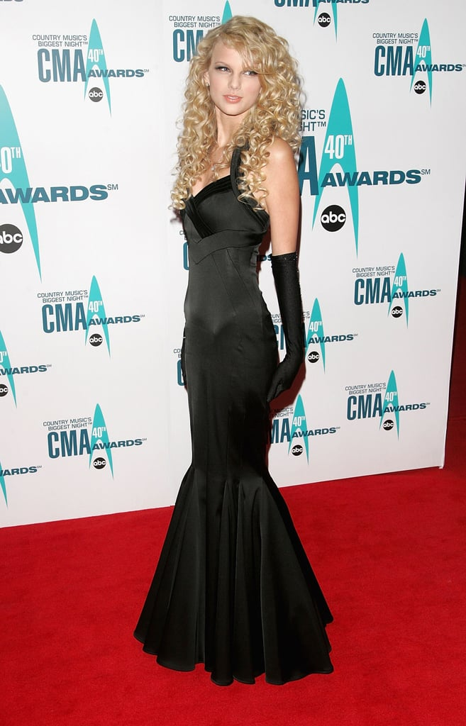 Swift's 2006 body-hugging fishtail gown was a little reminiscent of the sultry Jessica Rabbit —but in true Taylor form, the start sweetened up the look with au naturel curls and high-fashion evening gloves.