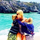 In April 2014, the actress posted a throwback snap of her kids giving her big hugs by the water.