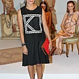 Rashida Jones dripped herself in Dannijo jewels at the label's Spring 2014 presentation. A red clutch and black ankle-strap pumps added further pizazz.