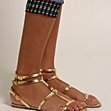 Gold Grecian-inspired sandals will go with everything you pack. Maje Nefertiti Gold Espadrille Sandal ($143, originally $285)
