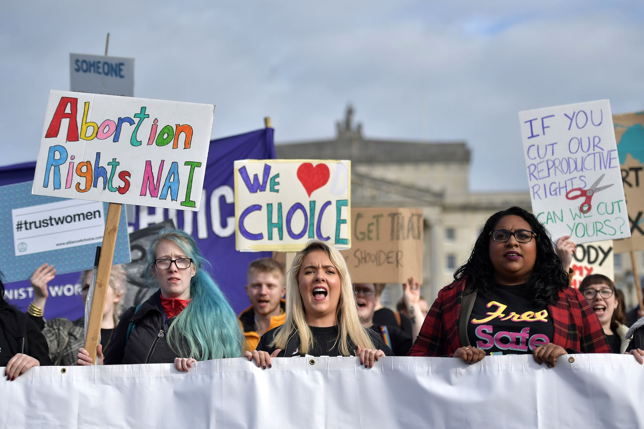 BELFAST, NORTHERN IRELAND - OCTOBER 21: Members of pro choice group Alliance for Choice make their way to Stormont on October 21, 2019 in Belfast, Northern Ireland. Legislation brought in by MPs at Westminster in the absence of the Northern Ireland power sharing executive meant that abortion will be decriminalised in the province unless the executive reconvened by the 21st of October. A last ditch attempt by the Democratic Unionist party led by Arlene Foster to block the imminent changers to Northern Ireland's strict abortion laws failed today due to the lack of cross party involvement at Stormont. (Photo by Charles McQuillan/Getty Images)