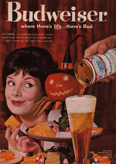 """""""SAY CHEESE. Or anything else good to eat. Everything tastes better with Budweiser,"""" reads this ad. Next time, ditch the wine and have a beer and cheese party."""