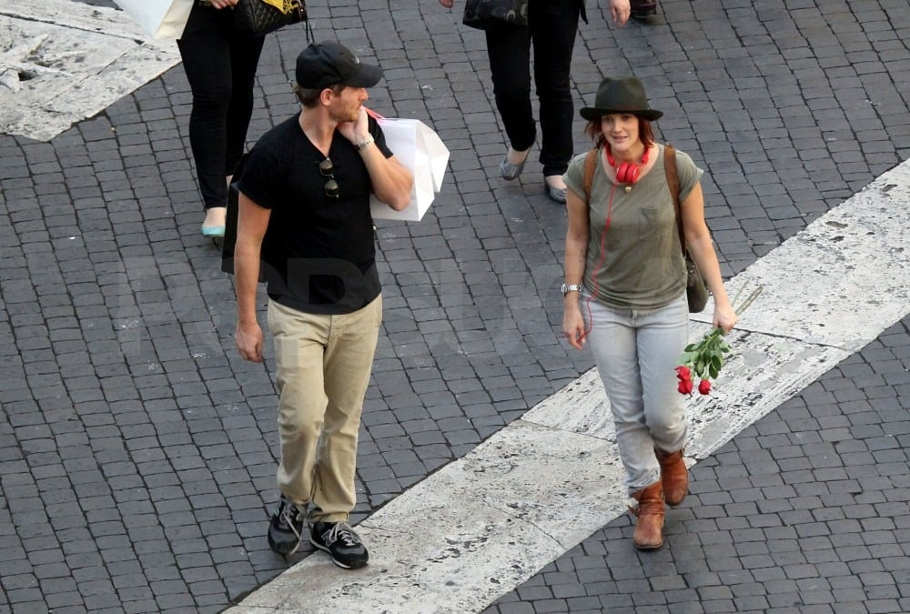 Drew walked home with a bunch of roses in her hand.