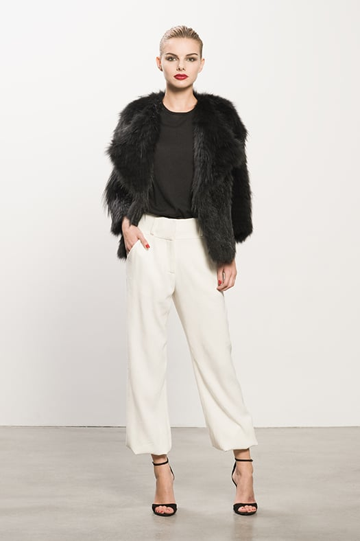 Coyote Black Fur Coat, Cashmere Black Tee, Crepe Cream Elastic Botton Pant, Whisper Black Suede Sandal. Photo courtesy of Tamara Mellon
