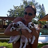 Bar Refaeli cuddled with three adorable puppies. Source: Twitter user BarRefaeli