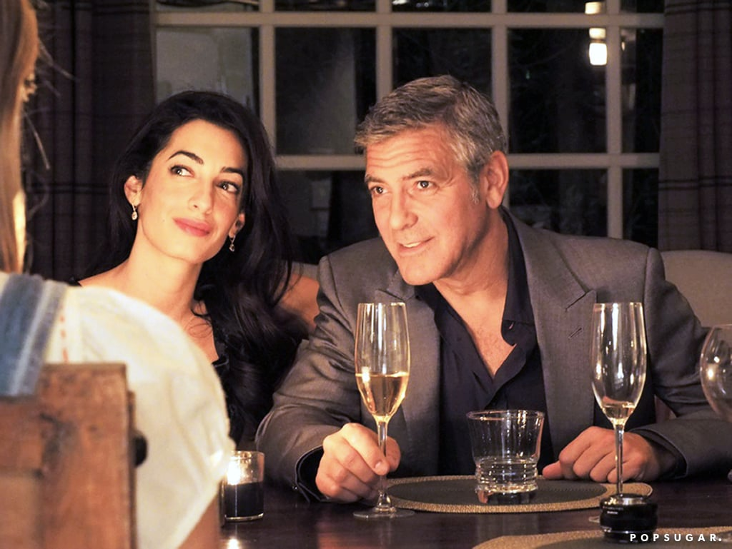 "George Clooney and his new fiancée, Amal Alamuddin, looked very much in love last month when they celebrated their engagement alongside pals Rande Gerber and Cindy Crawford in LA, shortly before their big relationship news went public. Amal flashed her massive ring during the party, which was reportedly designed by George himself and features an ethically mined 7-carat diamond on a platinum setting. Amal and George's engagement news broke in April. The reports were quickly confirmed when Amal's law firm sent out a press release to send the couple ""best wishes and congratulations"" on their big relationship news.  George was previously married in the early '90s to actress Talia Balsam, but their romance ended in divorce. (Don't feel bad for Talia, as she went on to get married to another silver fox, John Slattery, whom she costars with on Mad Men.) After he split with Talia, George went on to date many beautiful women, none of whom he ever got serious with enough to pop the question. However, it looks as if George has met his match with Amal. The partying wasn't over for the newly engaged couple as they hit up a bash with Rande and Cindy over the weekend in LA. The fete was reportedly a more public celebration for their engagement and rumored guests included U2 frontman Bono."