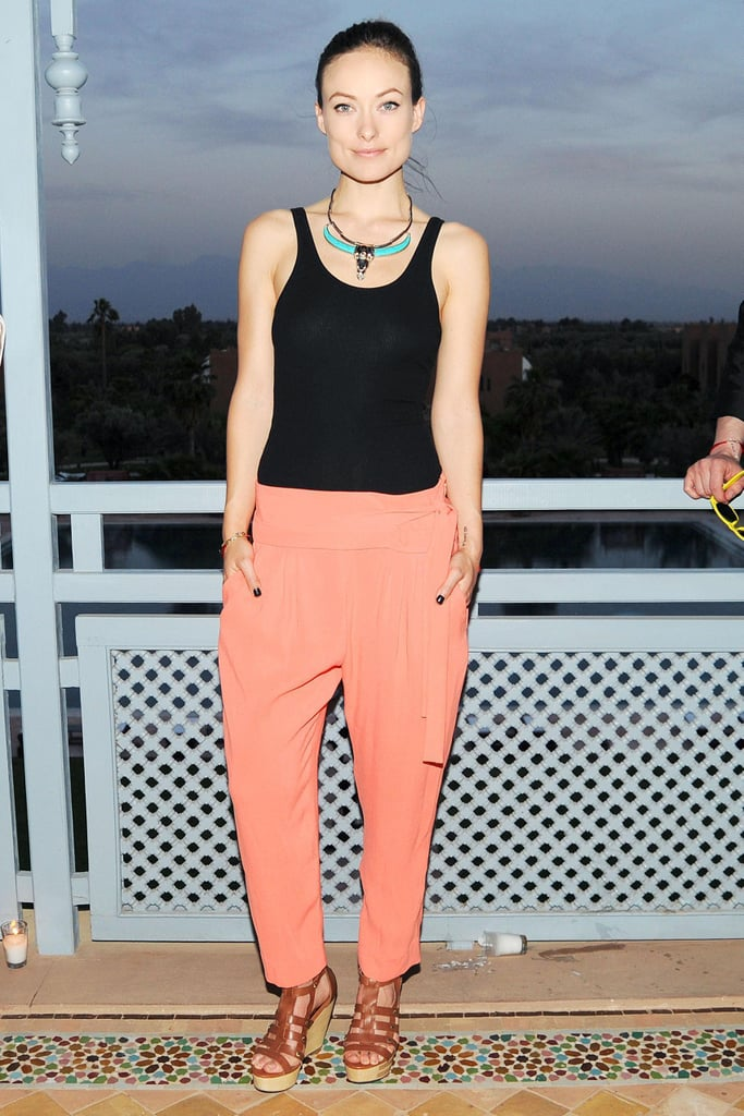 Olivia Wilde exuded effortlessness in a pair of loose-fitting orange trousers, a black tank, and Twelfth Street by Cynthia Vincent wedges in Marrakech.  Billy Farrell/BFAnyc.com
