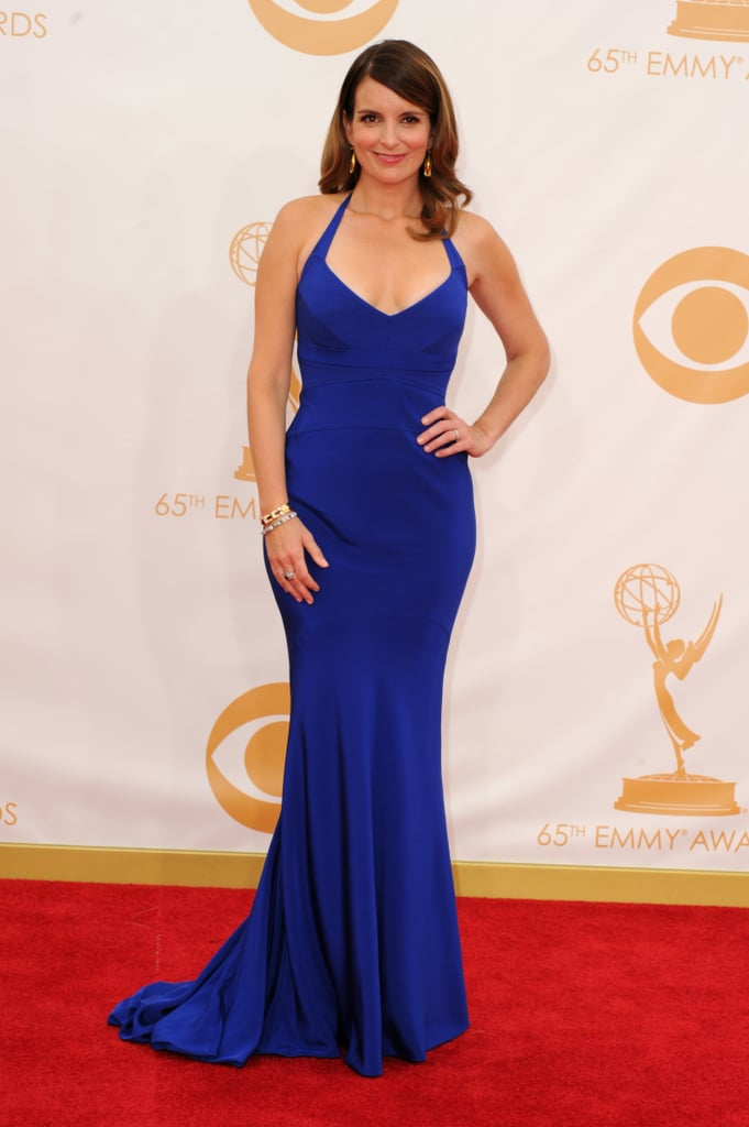 Tina Fey wore a beautiful blue Narciso Rodriguez gown on the red carpet at the 2013 Emmy Awards in LA. Tina has been nominated once again for her hilarious performance as Liz Lemon in 30 Rock, and her show just won for outstanding writing as well. She also teamed up with her good friend Amy Poehler as the first presenters of the show after heckling host Neil Patrick Harris from the front row. Weigh in on Tina's look and the rest of the Emmys style by voting on our fashion and beauty polls. — Additional reporting by Jess Chandra