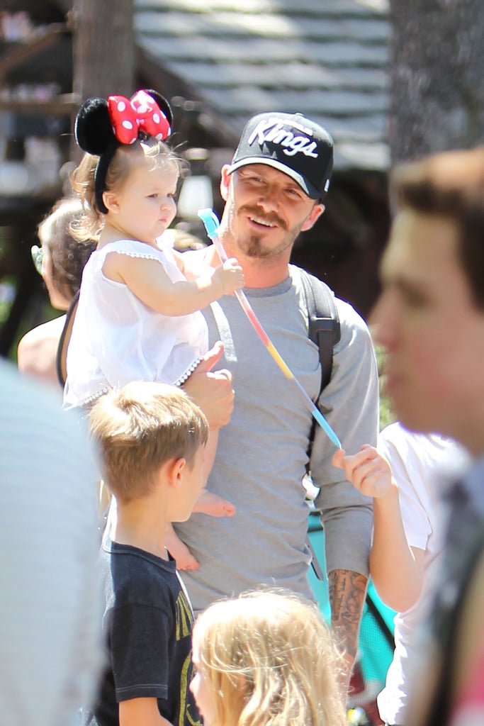 David Beckham carried Harper wearing Minnie Mouse ears around Disneyland.