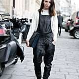 The city girl's overalls were crafted in leather, not denim.