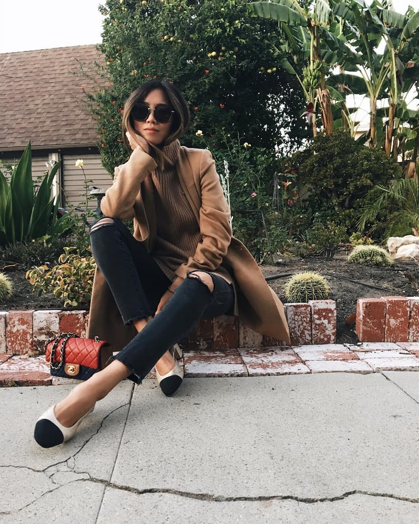 With a Camel Coat and Black Jeans