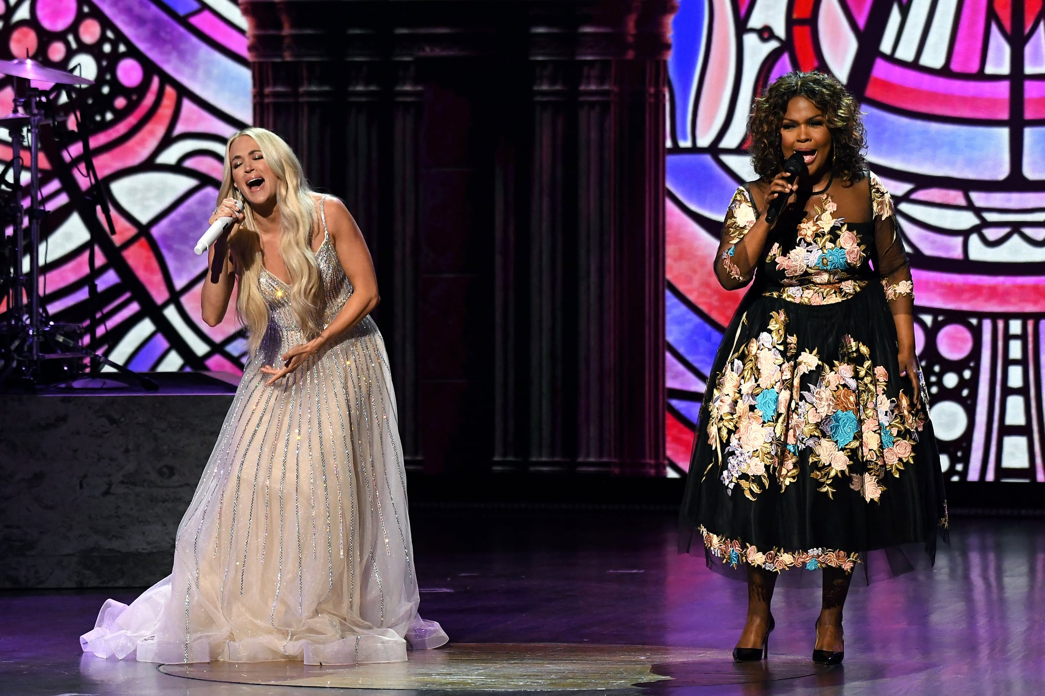 NASHVILLE, TENNESSEE - APRIL 18: (L-R) In this image released on April 18, Carrie Underwood and CeCe Winans perform onstage at the 56th Academy of Country Music Awards at the Grand Ole Opry on April 18, 2021 in Nashville, Tennessee. (Photo by Kevin Mazur/Getty Images for ACM)