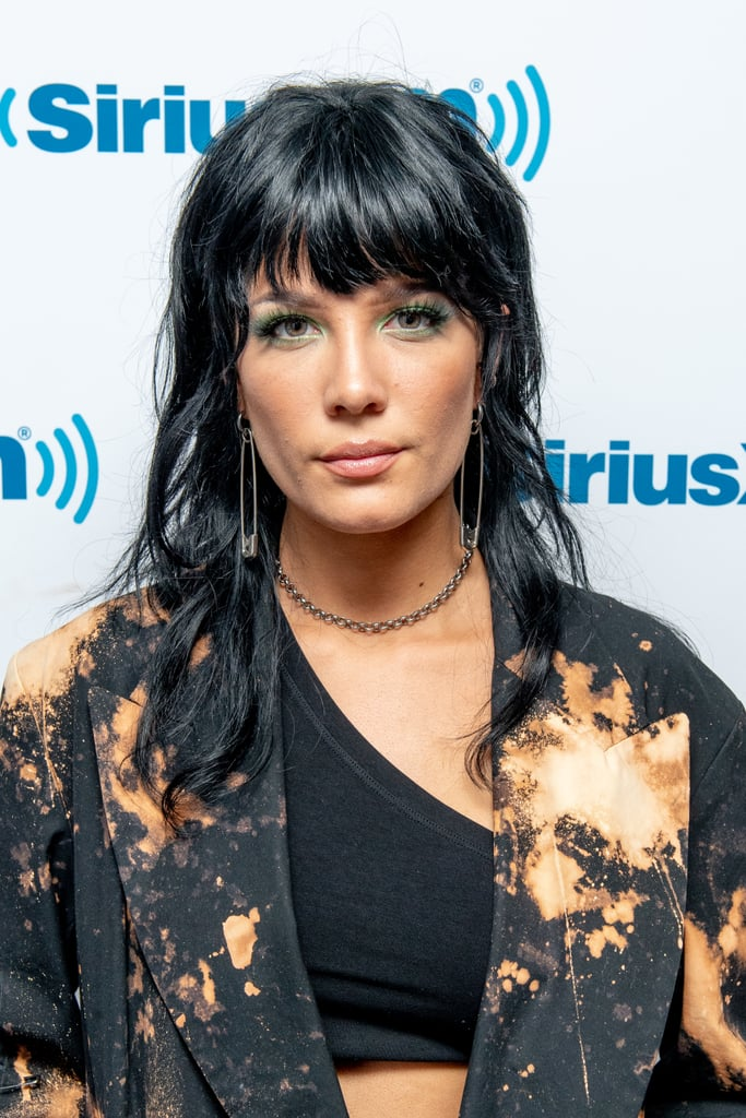"Halsey is constantly switching up her hair look, but her latest style will have you do a double take to ensure it's not a photo from the '80s. The pop star visited Sirius XM Studios with a black shag that looks a whole lot like Joan Jett's iconic look. We've recently seen a resurgence of the edgy cut, with other celebrities like Anne Hathaway and Taylor Swift trying out the trend.  NYC hairstylist Devin Toth previously told POPSUGAR that the cut is essentially a lob with bangs. ""There are variations of the bangs, the layers, and the hair textures,"" he said. While Halsey's new look might be a wig, it looks so natural on her that we think she should commit to the look full-time.  Check out her shag cut ahead, as well as a few snaps of Joan Jett's iconic hair."