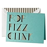 "These Kate Spade ""Pop Fizz Clink"" Holiday Cards ($24 for 10) are so glam, you'll probably want to keep one for yourself."