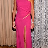 She wore a skin-baring pink number to the Scientific and Technical Awards in March 2002.