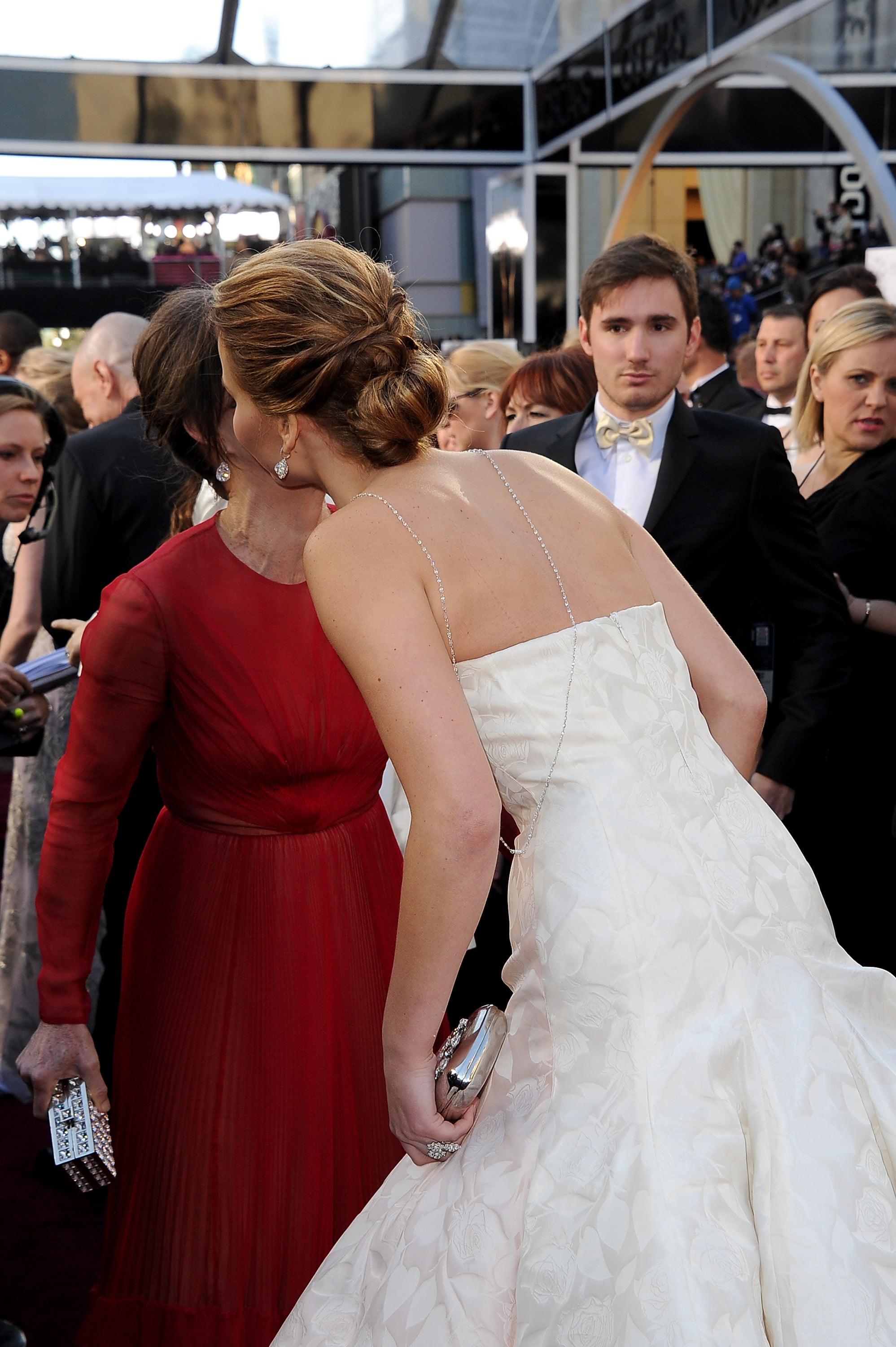 Jennifer Lawrence greeted Sally Field on the red carpet at the Oscars 2013.