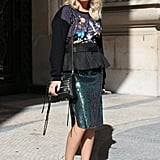 This styler gave us futuristic glam with a touch of sparkle, peplum, and perspex heels.