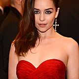 Emilia Clarke had her hair flipped far to the left with a rainbow effect in the front — how much more 80s can you get!