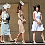 Eugenie and Kate Middleton led the group at a Buckingham Palace garden party in June 2014.