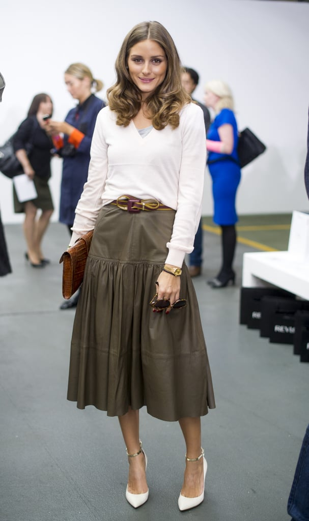 Olivia played ladylike with a contemporary angle at Antonio Berardi in London. In a Reiss top and skirt, she added in her quintessential dose of accessories, like a slim belt, Hermès clutch, and Valentino heels, to give the separates her own twist. 8761803