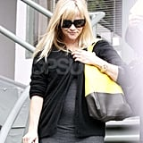 Pregnant Reese Witherspoon wore an oversize black and yellow bag in LA.