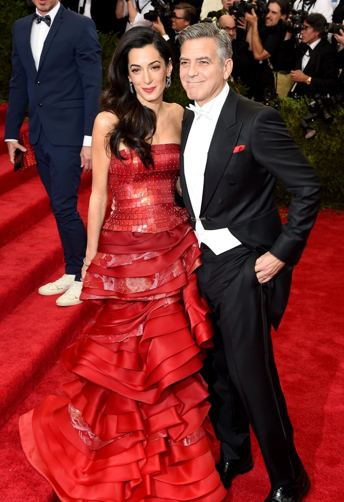 George and Amal Clooney were just one of the stunning duos to hit the red carpet at the Met Gala in NYC on Monday night. The couple stayed close as they made their way into the Metropolitan Museum of Art for the opening of the China: Through the Looking Glass exhibit. Amal chose a fiery red gown for the special occasion, while George coordinated with a red pocket square tucked into his tuxedo. The couple have been spending time in the Big Apple while George films Money Monster, though he's made time for plenty of date nights with Amal and even her parents.