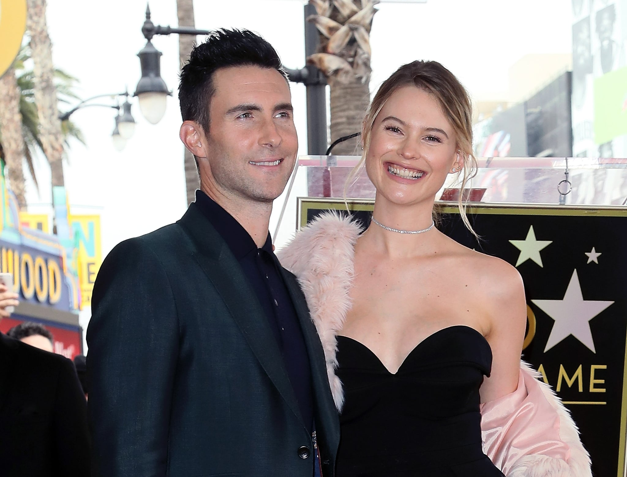 HOLLYWOOD, CA - FEBRUARY 10:  Recording artist Adam Levine (L) and wife model Behati Prinsloo attend his being honoured with a Star on the Hollywood Walk of Fame on February 10, 2017 in Hollywood, California.  (Photo by David Livingston/Getty Images)