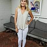 She paired white jeans with a simple striped tank top. Lesson from Lauren: choose a structured top for an elevanted spin on jeans and a tee.