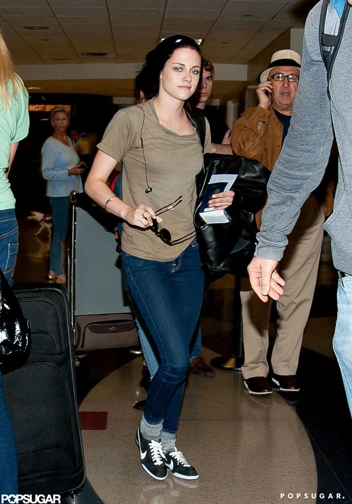 Kristen Stewart arrived at LAX last night fresh off an international flight from France. Kristen modeled designer gowns from Balenciaga and Reem Acra during her stay in Cannes, but on her return trip, she was more comfortable in a pair of skinny jeans and Nike sneakers. Kristen was in Cannes promoting her upcoming release, On the Road, and also found time to attend a screening of Robert Pattinson's latest project, Cosmopolis. Rob and Kristen stuck close and held hands at his postpremiere celebration and were making out at her On the Road afterparty.  Kristen's shifting her focus back to another project, Snow White and the Huntsman. Her fairy tale hits the big screen on Friday, and we've got the first episode of our I'm a Huge Fan: Kristen Stewart coming your way!
