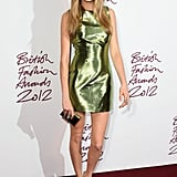Cara Delevingne struck a pose in a futuristic Burberry pairing — a shimmering lime-green minidress and silver python wedges — at the 2012 British Fashion Awards in London.