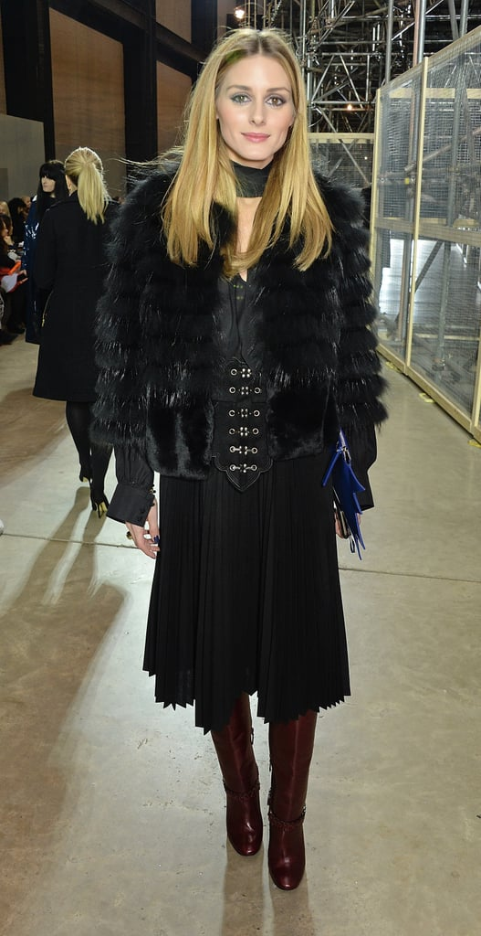 When Olivia stepped out for Christopher Kane, she played with texture and proportion in a pleated skirt and furry jacket.