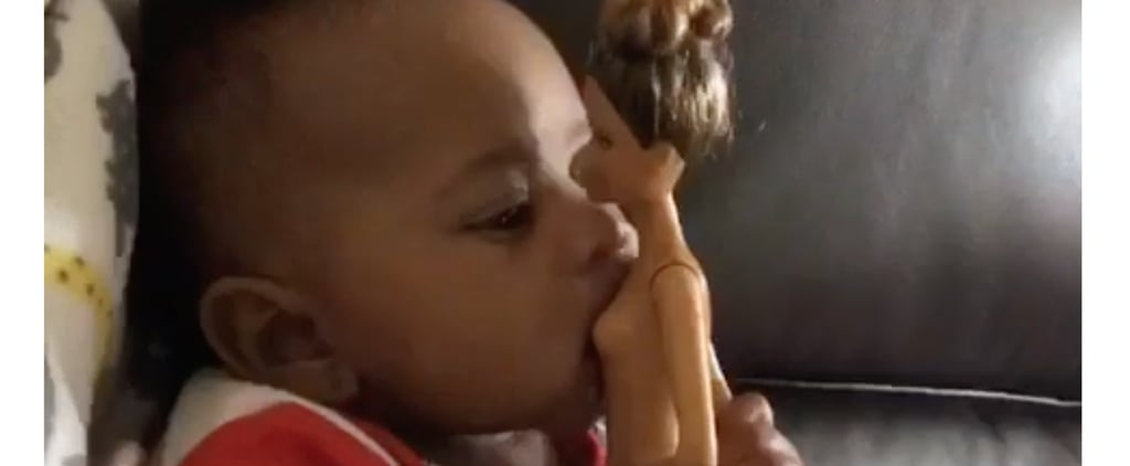Baby Trying to Breastfeed Off a Naked Barbie Doll