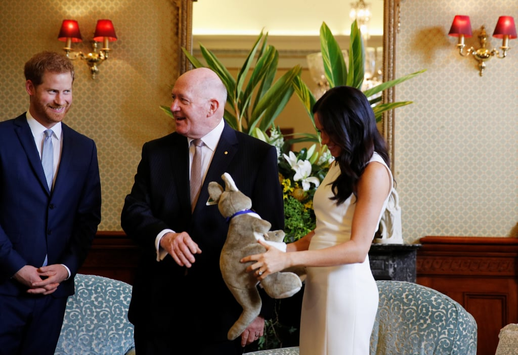 "Meghan Markle and Prince Harry only just announced that they're expecting their first child, but they've already received their first baby gift. On Tuesday, the royals kicked off their tour of Australia and they were gifted a kangaroo stuffed toy from Governor-General Sir Peter Cosgrove and his wife, Lady Cosgrove. As the governor-general presented Meghan with the sweet gift, which came complete with a pair of UGG boots, Meghan excitedly said, ""Our first baby gift!"" Are you crying yet? Harry and Meghan first got together in May 2016 and tied the knot two years later in a lavish ceremony at Windsor's St. George's Chapel. Both Meghan and Harry have opened up in the past about wanting to start a family, and now it's finally happening! So exciting!       Related:                                                                                                           Meghan Markle Confided in This Person About Her Pregnancy Before Telling the Royal Family"