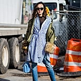 Turn your Summer dress into a Fall look by layering a sheer bodysuit and a pair of hemmed jeans underneath. Cover up with a puffer jacket for the ultimate street style look.