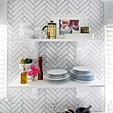 Floating shelves gave Kristin the open feeling she craved while allowing her to still show off the tiled accent wall.
