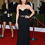 Tina Fey wore a black Oscar de la Renta gown.