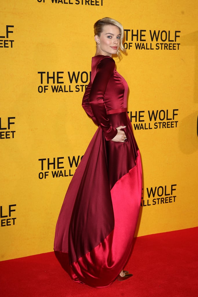 Margot Robbie's Oscar de la Renta gown took inspiration from the sexy tone of The Wolf of Wall Street, while its twirling train and scarlet hue made us think of another cinematic classic.