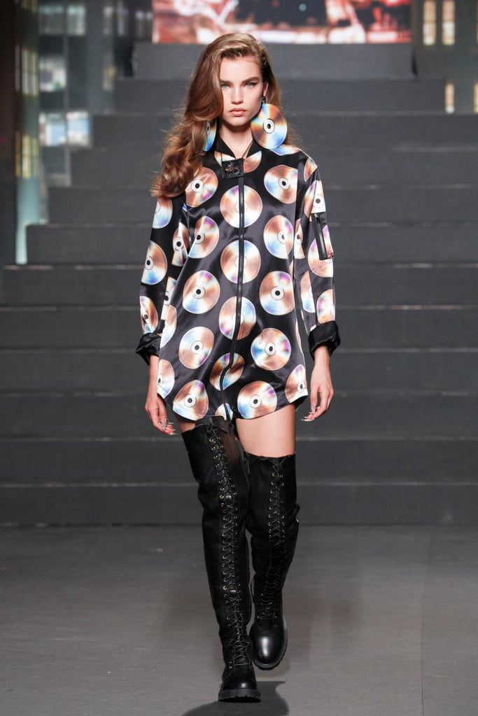 A Model Wearing a CD-Print Dress and Matching Earrings