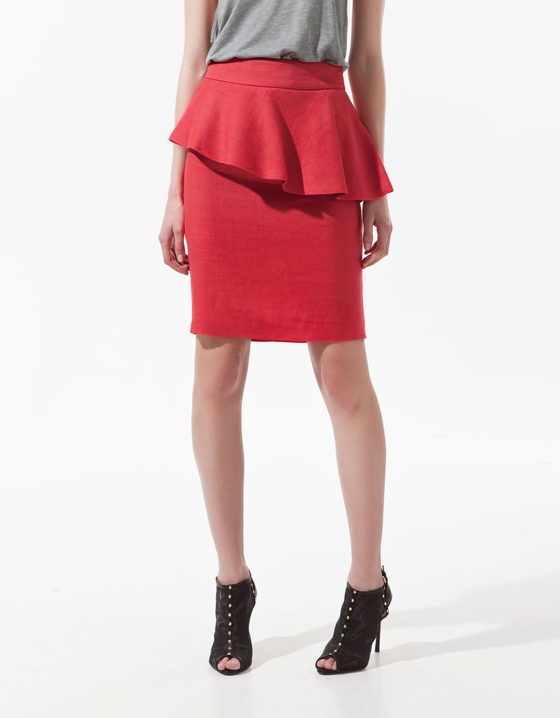 """I've become a little obsessed with the idea of sprucing up my office attire. This skirt is so much cooler than your average pencil, and I love the flash of bright red and alluring peplum. I'm planning to add a simple black tank and a pair of lace-up heels to channel a more effortless take on the ladylike trend."" — Hannah Weil, assistant editor  Zara Pencil Skirt With Frill ($80)"