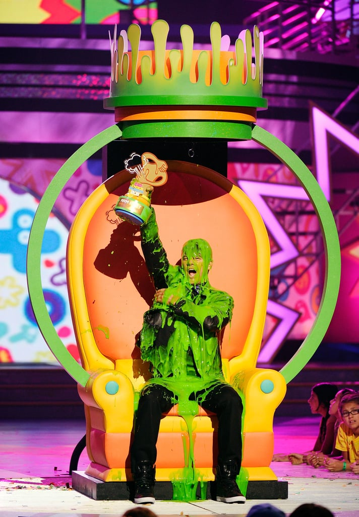 The Nickelodeon Kids' Choice Awards roll into LA on Saturday, which means it's time for celebrities to be very afraid — at any moment, they could be slimed. Through the years, we've seen plenty of stars coated in green gunk, from Kristen Stewart's slimy hug to Justin Timberlake's slime fight to Josh Duhamel becoming the reigning king of slime time. Scroll through to see 23 of the best moments of celebs in the slimelight, and then tune in for the show to see who comes out green.
