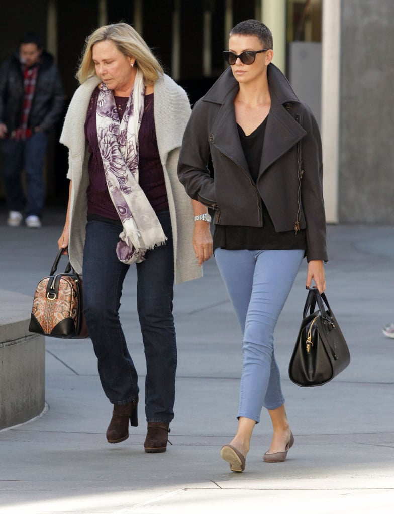 Charlize Theron was out and about in LA on Saturday, grabbing lunch in Beverly Hills and catching a movie at the ArcLight with her mom, Gerda. Charlize is back on the West Coast after a stint in South Africa, where she filmed Mad Max 4: Fury Road. She shaved her head for the role in June, and is still sporting her cropped locks. Charlize brought her mom and her son, Jackson, who was just one of many celebrity babies welcomed in 2012, to her native country during production.   Charlize will soon turn her attention to her next project, since it was recently confirmed that she'll star in and produce the remake of the 2005 South Korean movie, Sympathy For Lady Vengeance.