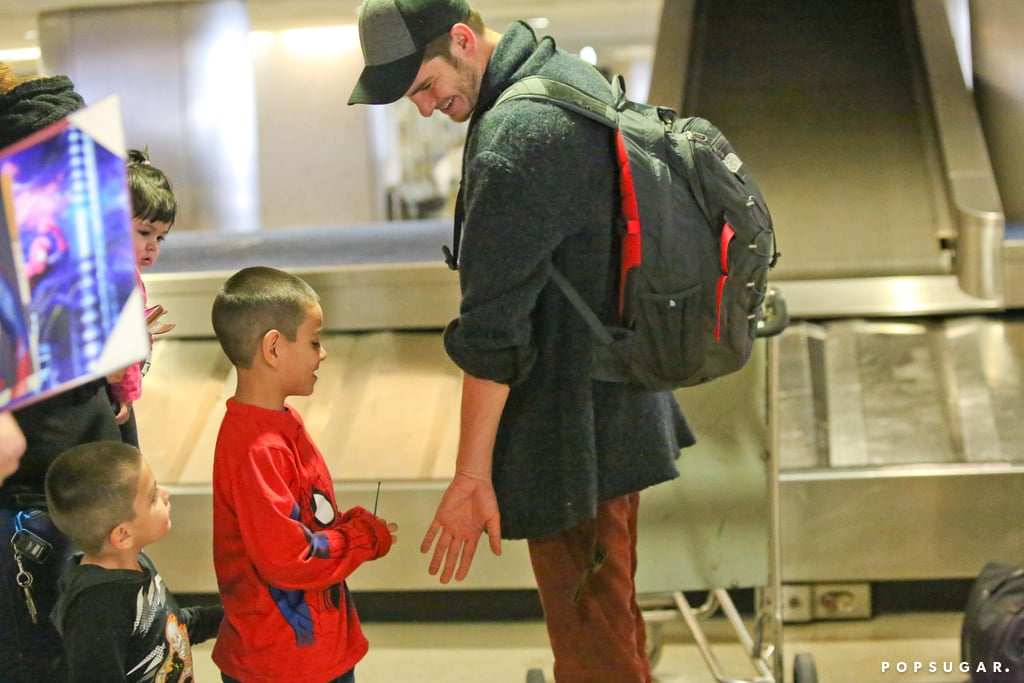Source: AKM-GSI Andrew Garfield was all smiles after touching down in LA on Monday, signing autographs and chatting with fans at the airport. In one especially heart-melting moment, Andrew reached out to high five a boy in a Spider-Man t-shirt before posing for pictures with him. It looks like the star has plenty to be happy about, as he kicked off the year with a Hawaiian vacation alongside his on- and offscreen girlfriend, Emma Stone. The pair soaked up some sun while surfing, taking a bit of a break over the holidays after shooting their upcoming film, The Amazing Spider-Man 2. Andrew and Emma made an official appearance together during a photocall for the movie, where they both had fun goofing off with fans. The movie doesn't open until May 2, but you can get excited now by checking out the first official trailer.
