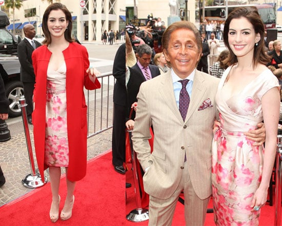 Anne Hathaway Helps Induct Valentino Into The Rodeo Drive Walk Of Style in a Floral Pink Dress and Red Coat
