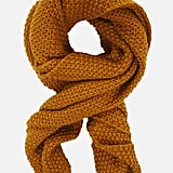 The saturated mustard hue of this BCBG Max Azria knitted scarf ($38) is the perfect color to add to your autumnal lineup.
